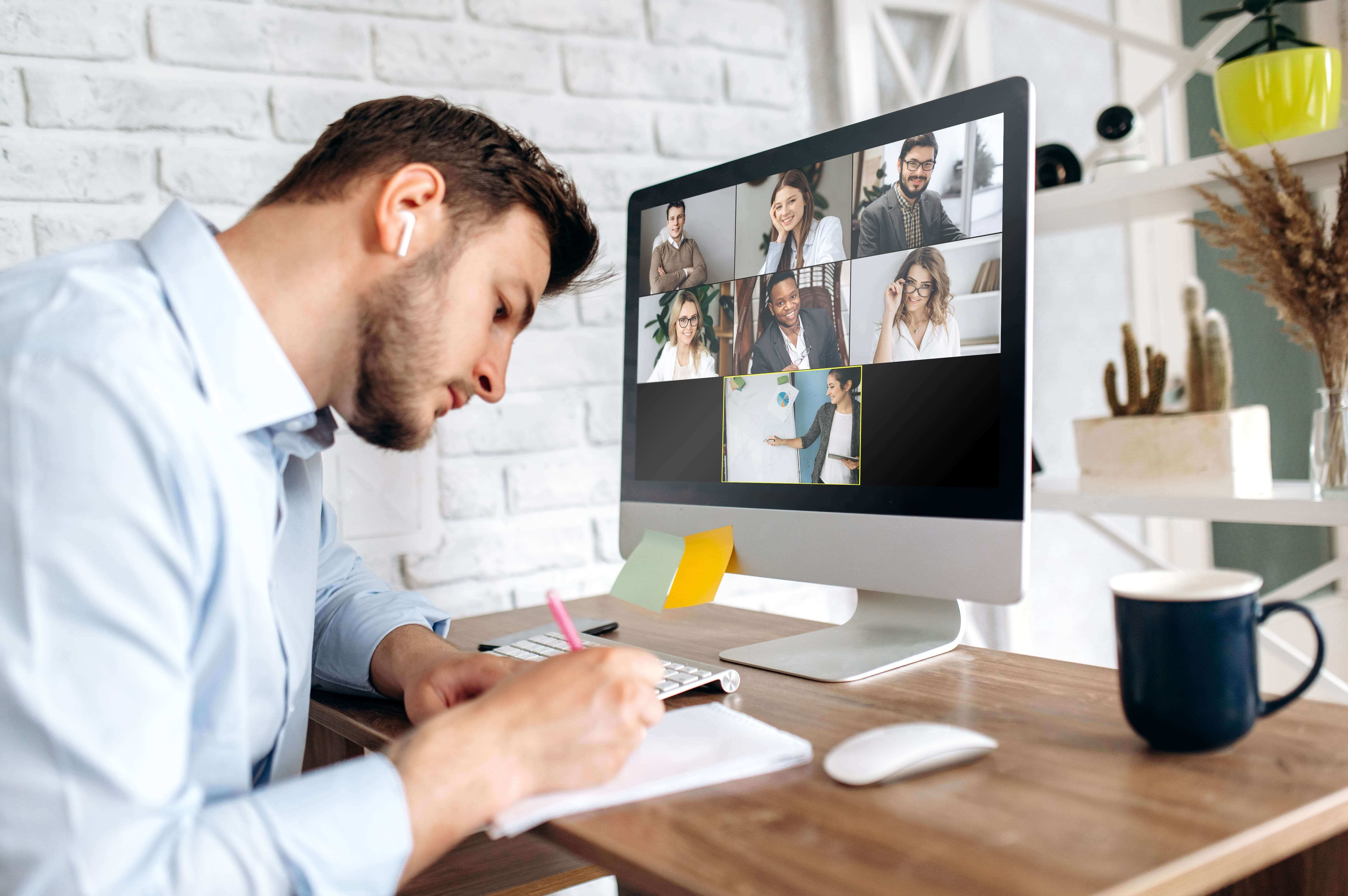 Man with Earbuds on Video Conf. Call